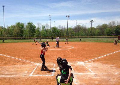 people on a baseball field playing baseball