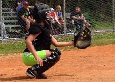 someone in baseball gear, squatting